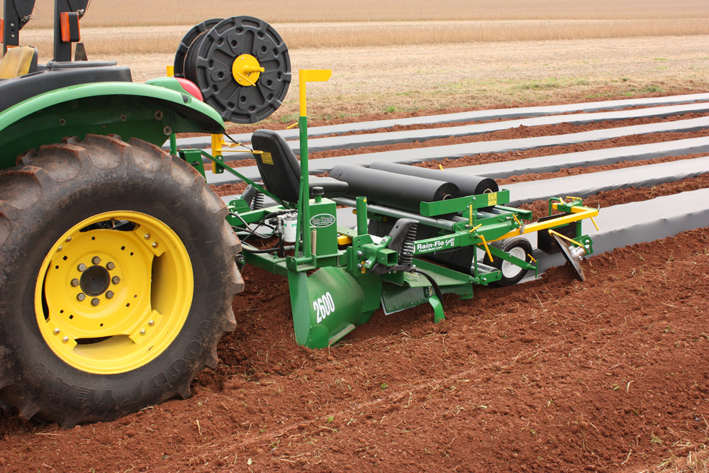 2600 Rain Flo Mulch Laying Equipment lays up to 5 foot